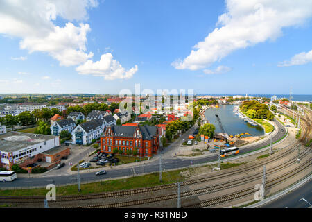 View of the Alter Strom canal, railway station and old town in the coastal port city of Warnemunde, Germany on the Baltic Sea. - Stock Photo