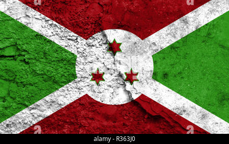 Flag of Burundi close up painted on a cracked wall, concept of armed actions and conflicts in the world - Stock Photo