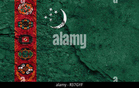 Flag of Turkmenistan close up painted on a cracked wall, concept of armed actions and conflicts in the world - Stock Photo