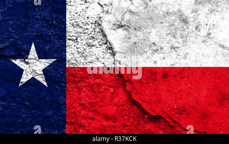 Flag State of Texas close up painted on a cracked wall, concept of armed actions and conflicts in the world - Stock Photo