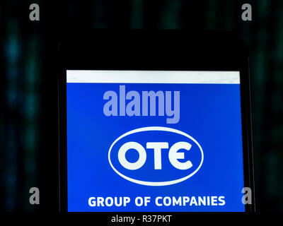 OTE Telecommunications company logo seen displayed on smart phone. Hellenic Telecommunications Organisation S.A., usually known by its Greek initials OTE, is the dominant telecommunications provider in Greece. - Stock Photo