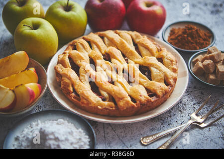 Traditional baked apple pie cake served on ceramic plate - Stock Photo