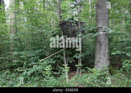 high seat with camouflage net - Stock Photo