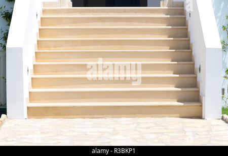 Empty stairs in front of a house - Stock Photo