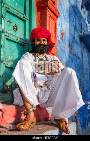 Man from Rajasthan dressed in traditional Indian clothes, Jodhpur, Rajasthan, India - Stock Photo