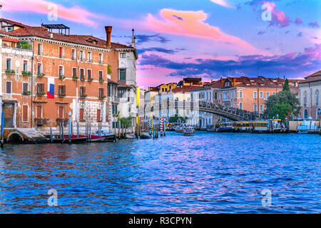 Colorful Ponte dell Academia Bridge. Sunset ferry docks, Grand Canal, Venice, Italy - Stock Photo