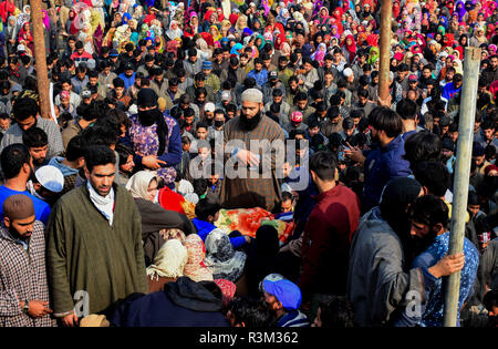 November 23, 2018 - A large crowd attend the funeral of Azad Ahmad Malik, an alleged top commander of Lashkar-e-Toiba, in the Arwani Area of the Kulgam district in Indian Administered Kashmir, on 23 November 2018. Malik was killed during a confrontation with Indian Forces in the Shalgund village of Dashnipora in the south Kashmir's Anantnag district on Friday and he was one of six alleged rebels killed in the gunfight. The five other separatist militants who died in the fierce encounter have been identified as Basit Mir of Khanabal, Anees of Takyibal, Aqib of Waghama Bijbehara, Shahid from Awa - Stock Photo