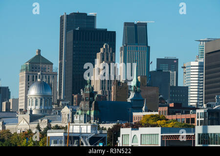 Canada, Quebec, Montreal. Old Port area city skyline view from St. Lawrence River. - Stock Photo