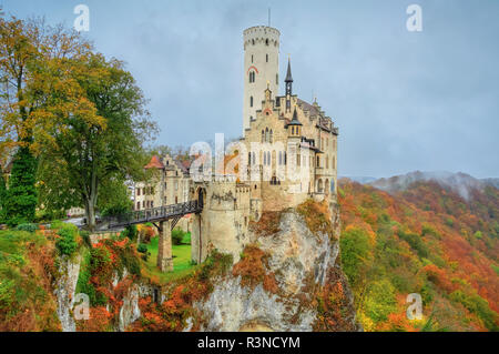 Autumn landscape with Lichtenstein Castle built in Gothic Revival style, Baden-Wuerttemberg, Germany - Stock Photo