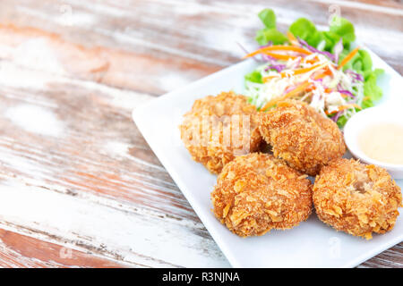 delicious fried shrimp, Thai seafood style, with sweet sauce and vegetable salad in white plate with copy space of wood table for food and healthy con - Stock Photo