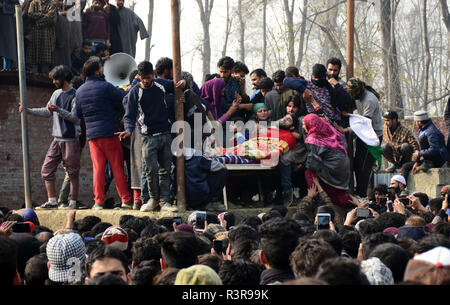 People watch the funeral of Azad Ahmad Malik alias Dada in Arwani Area of Kulgam district, Indian Administered Kashmir, some 70 kilometers away from Srinagar on 23 November 2018 Malik was killed in Shalgund village of Dashnipora in Bijbehara area of south Kashmir's Anantnag district on Friday. The slain Rebels have been identified as Azad Ahmad Malik alias Dada of Arwani, Basit Mir of Khanabal, Unais/ Anees of Takyibal, Bijbehara, Aqib of Waghama Bijbehara, Shahid from Awantipora and Firdaus Ahmad of Machpona Pulwama. (Photo by Muzamil Mattoo/Pacific Press) - Stock Photo