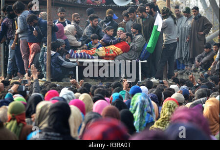 People attend the funeral of Azad Ahmad Malik alias Dada in Arwani Area of Kulgam district, Indian Administered Kashmir, some 70 kilometers away from Srinagar on 23 November 2018 Malik was killed in Shalgund village of Dashnipora in Bijbehara area of south Kashmir's Anantnag district on Friday. The slain Rebels have been identified as Azad Ahmad Malik alias Dada of Arwani, Basit Mir of Khanabal, Unais/ Anees of Takyibal, Bijbehara, Aqib of Waghama Bijbehara, Shahid from Awantipora and Firdaus Ahmad of Machpona Pulwama. (Photo by Muzamil Mattoo/Pacific Press) - Stock Photo