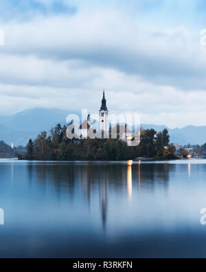 Evening autumn view of Bled lake in Julian Alps, Slovenia. Pilgrimage church of the Assumption of Maria on a foreground. Landscape photography - Stock Photo