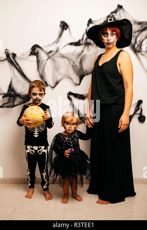 Mother and her two children dressed up for Halloween - Stock Photo