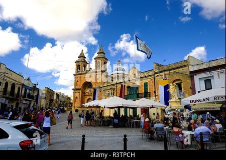 Marsaxlokk, Malta - 7th October 2018:Parish Church of Our Lady of Pompei and the market - Stock Photo