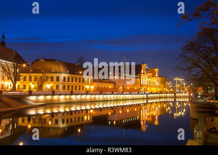 Wroclaw, Poland, August 2018.Ossolineum Library. With reflection in Odra River at night. - Stock Photo