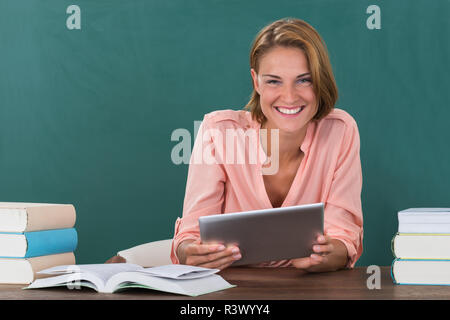 Teacher With Books And Digital Tablet - Stock Photo