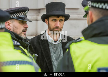 London, UK. 24th Nov 2018. Supporters are arrested for lying down in front of the entrance of Downing Street. Extinction Rebellion -  co hosted by Rising Up, 'Rebel Against the British Government For Criminal Inaction in the Face of Climate Change Catastrophe and Ecological Collapse'. Credit: Guy Bell/Alamy Live News - Stock Photo