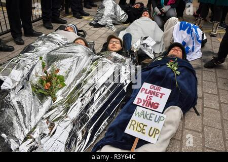 London, UK. 24th Nov 2018. Extinction Rebellion/Rebellion Day 2. Protesters staged a lie in outside the gates of Downing Street, London, UK Credit: michael melia/Alamy Live News - Stock Photo