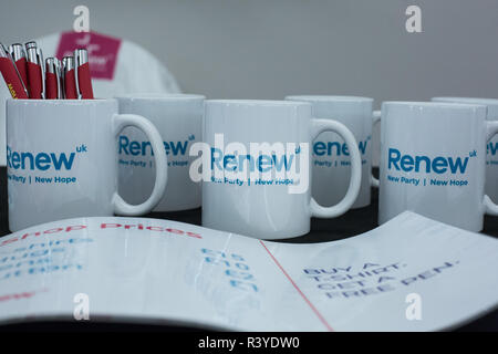 London, UK. 24th November, 2018. Mugs and pens on sale at the inaugural National Assembly of Renew UK, a new centrist political party launched in February 2018. Led by Annabel Mullin, James Torrance and James Clarke, Renew UK has signed up 100 candidates ready to stand in future UK elections based on a wide-ranging programme of reform. Credit: Mark Kerrison/Alamy Live News - Stock Photo