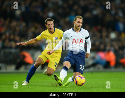 London, UK. 24th Nov, 2018. Christian Eriksen (R) of Tottenham Hotspur vies with Cesar Azpilicueta during the English Premier League match at the Wembley Stadium in London, Britain on Nov. 24, 2018. Tottenham won 3-1. Credit: Marek Dorcik/Xinhua/Alamy Live News - Stock Photo