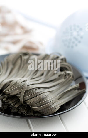 black noodles with squid sepia ink - Stock Photo