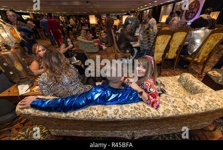 Buffalo, New York, USA. 25th Nov, 2018. The World's Largest Disco, celebrating its 25th anniversary this year, draws some 7,000 people to the Buffalo-Niagara Falls Convention Center every year for a chance to dress up in 70's-style clothing and dance the night away to disco music. All of the event's proceeds go to Camp Good Days and Special Times, an orginzation which supports people in their fight against cancer. Credit: Brian Cahn/ZUMA Wire/Alamy Live News - Stock Photo