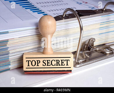 Top Secret rubber stamp in the office - Stock Photo