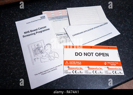The Full Bowel Cancer home testing kit. Do Not Open. - Stock Photo