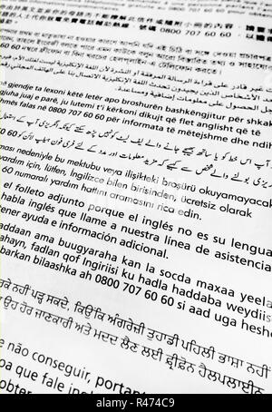 Closeup of translations in various languages to the NHS Bowel Cancer home testing kit instructions - Stock Photo
