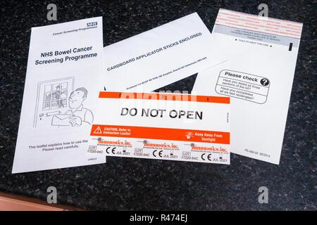 The Full Bowel Cancer home testing kit. Do Not Open. - Stock Photo