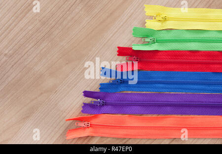 zippers wooden background - Stock Photo