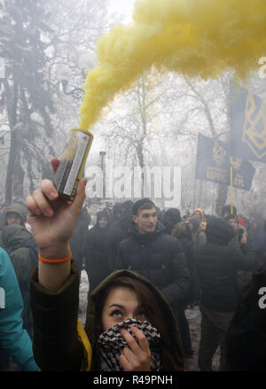 Kiev, Ukraine. 26th Nov, 2018. Ukrainian activists of National Corps take part at their protest in front the Ukrainian Parliament building in Kiev, Ukraine, on 26 November 2018. The protesters gathered due an incident with three Ukrainian navy ships captured by Russian special forces, which Russia blocked from passing through the Kerch Strait into the Sea of Azov in the Black Sea on 25 November 2018. Credit: Serg Glovny/ZUMA Wire/Alamy Live News - Stock Photo