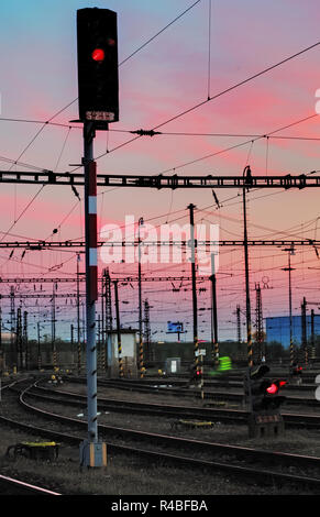 Railway Tracks at a pink  colorful sunset - Stock Photo