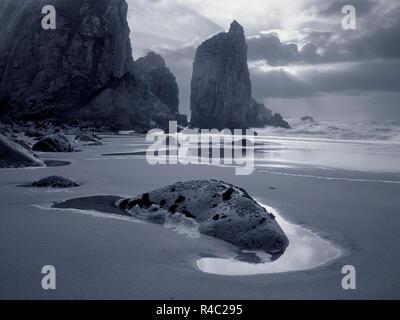 Rocky beach at sunset before rain and storm. Ursa (bear) beach, Portugal. Analog: Medium Format slide film. Toned blue - Stock Photo