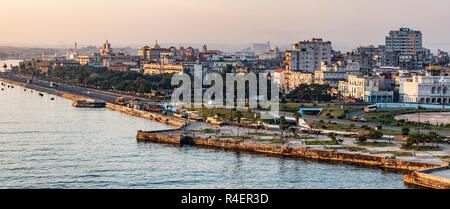 Havana, Cuba - 25 July 2018: View of Old Havana coastline looking at construction on El Malecone road at sunrise taken from on top of a cruise ship. - Stock Photo