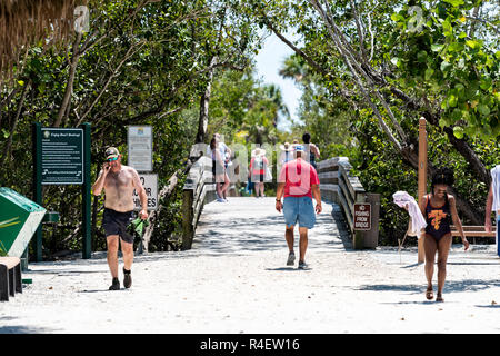 Sanibel Island, USA - April 29, 2018: Bowman's beach with sandy trail, path, walkway, bridge, many people, tourists walking - Stock Photo