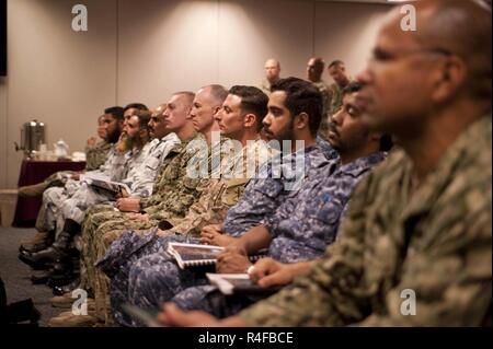 NAVAL SUPPORT ACTIVITY BAHRAIN (Oct. 24, 2016) A multinational group of enlisted service members listen to Vice Adm. Kevin Donegan, commander of U.S. Naval Forces Central Command, speak during the first Combined Joint Maritime Enlisted Leadership Development Program (ELDP) Back Bone University in Bahrain. ELDP is designed to instill and improve upon six enlisted desired leader attributes; operate with commander's intent, make sound and ethical decisions, enable the force, anticipate, communicate and mitigate risk, operate jointly and think critically using the NCO/PO Handbook published by the  - Stock Photo