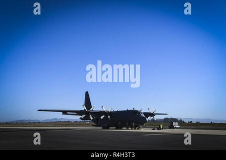 Airmen from Cannon Air Force Base prepare an AC-130W Stinger II for takeoff from Vandenberg Air Force Base, Calif., Sept. 20, 2018. Live-fire training wrapped up the Full Mission Profile exercise. - Stock Photo