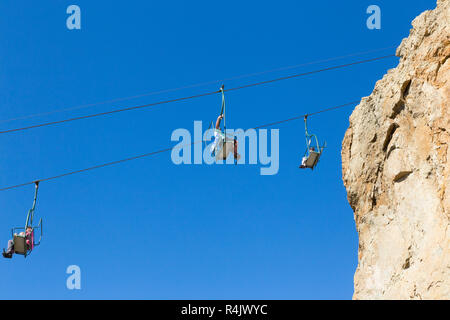 Needles Chairlift cables and cable cars near the top of the cliffs above Alum Bay Cliffs. Chairlift takes visitors to the beach & the bay. Isle of Wight. UK (98) - Stock Photo