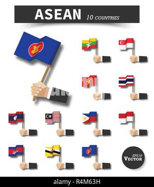 ASEAN . Association of Southeast Asian Nations . Hand of businessman hold and wave flag pole on white isolated background . Flat design . Elements vec - Stock Photo