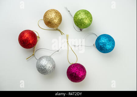 composition of Christmas colorful balls lie on a light background. Winter season. - Stock Photo