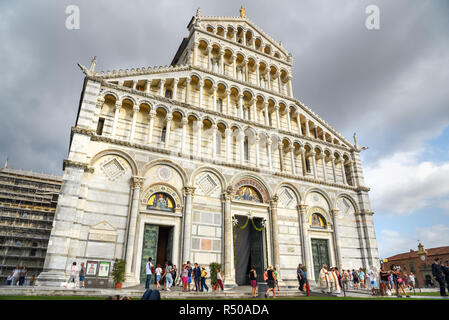 Pisa, Italy - September 23, 2018: Pisa Cathedral or Duomo di Santa Maria Assunta. A lot of tourists on Piazza dei Miracoli or Square of Miracles - Stock Photo