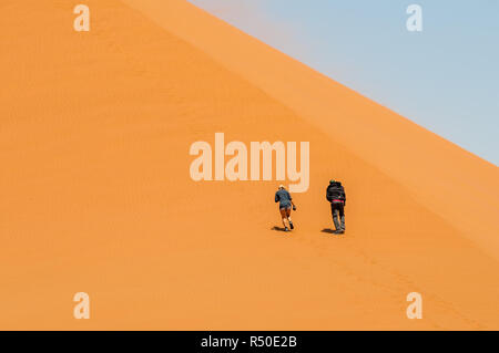 two persons climning Dune 45 ,namib desert, Namibia - Stock Photo