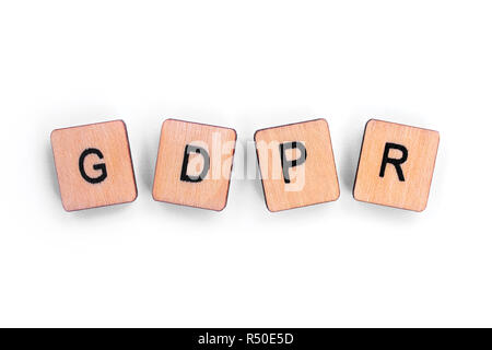 The abbreviation GDPR - General Data Protection Regulation, spelt with wooden letter tiles over a plain white background. - Stock Photo