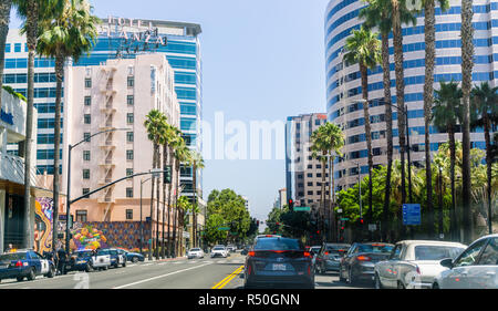 August 17, 2018 San Jose / CA / USA - Busy street lined up with tall buildings in downtown San Jose on a sunny day, Silicon Valley - Stock Photo