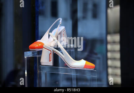 PRADA shoes in a shop window - Stock Photo