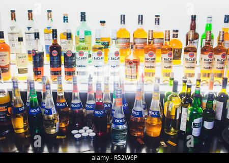 Ufa, Russia, Darling Bar, 20 November, 2018: Various alcohol bottles in a bar, back light, all logos. - Stock Photo