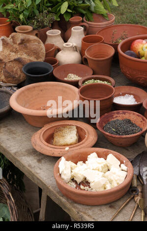 Ingredients shown in jars and bowls, at a display of Roman army life. - Stock Photo