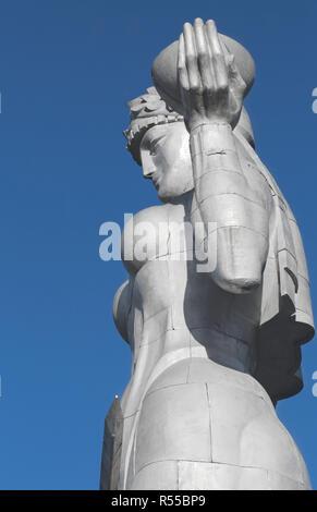Aluminium statue of a woman in traditional Georgian attire - Huge Kartvlis Deda (or Kartlis Deda) - Stock Photo